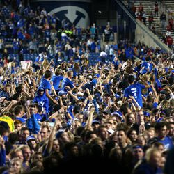 Fans swarm the field after BYU defeated Utah in an NCAA football game at LaVell Edwards Stadium in Provo on Saturday, Sept. 11, 2021. BYU won 26-17, ending a nine-game losing streak to the Utes.