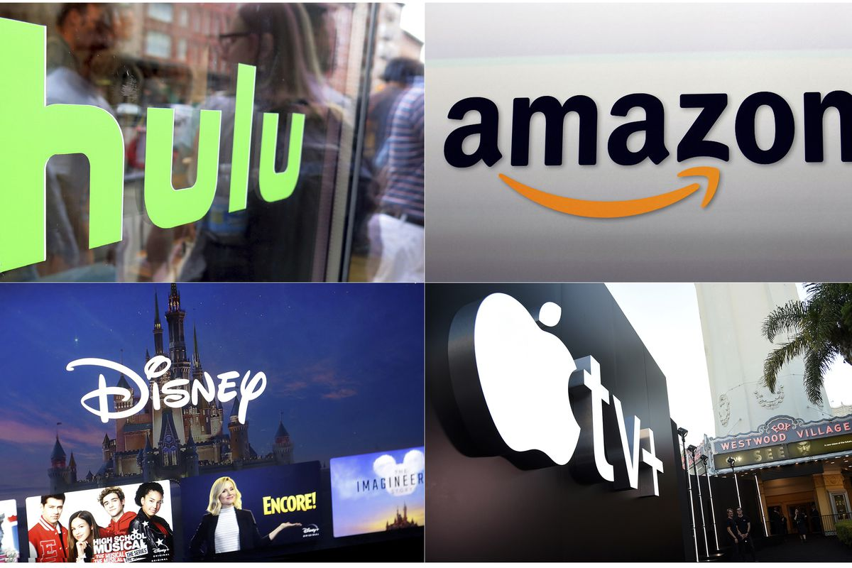 This combination photo shows, clockwise from top left, the Hulu logo on a window at the Milk Studios space in New York, the Amazon logo in Santa Monica, Calif., the Apple TV+ logo displayed outside the Regency Village Theatre in Los Angeles, and a screen grab of the Disney Plus streaming service on a computer screen.