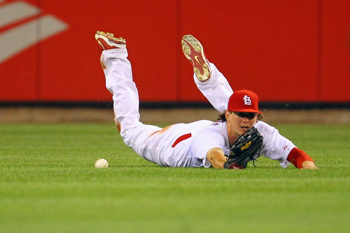 ST. LOUIS, MO - JUNE 1: Colby Rasmus #28 of the St. Louis Cardinals mis plays a fly ball against the San Francisco Giants at Busch Stadium on June 1, 2011 in St. Louis, Missouri.  (Photo by Dilip Vishwanat/Getty Images)