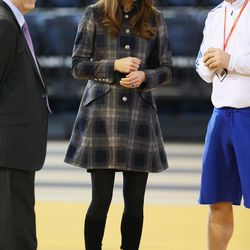 Taking in a sporting match in Scotland on April 4th, 2013 in a plaid Moloh coat.