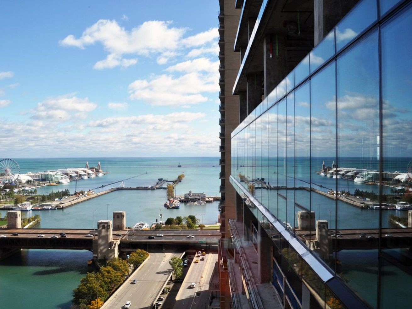 Vista's new glass capturing a crisp reflection of the Chicago River and Navy Pier.