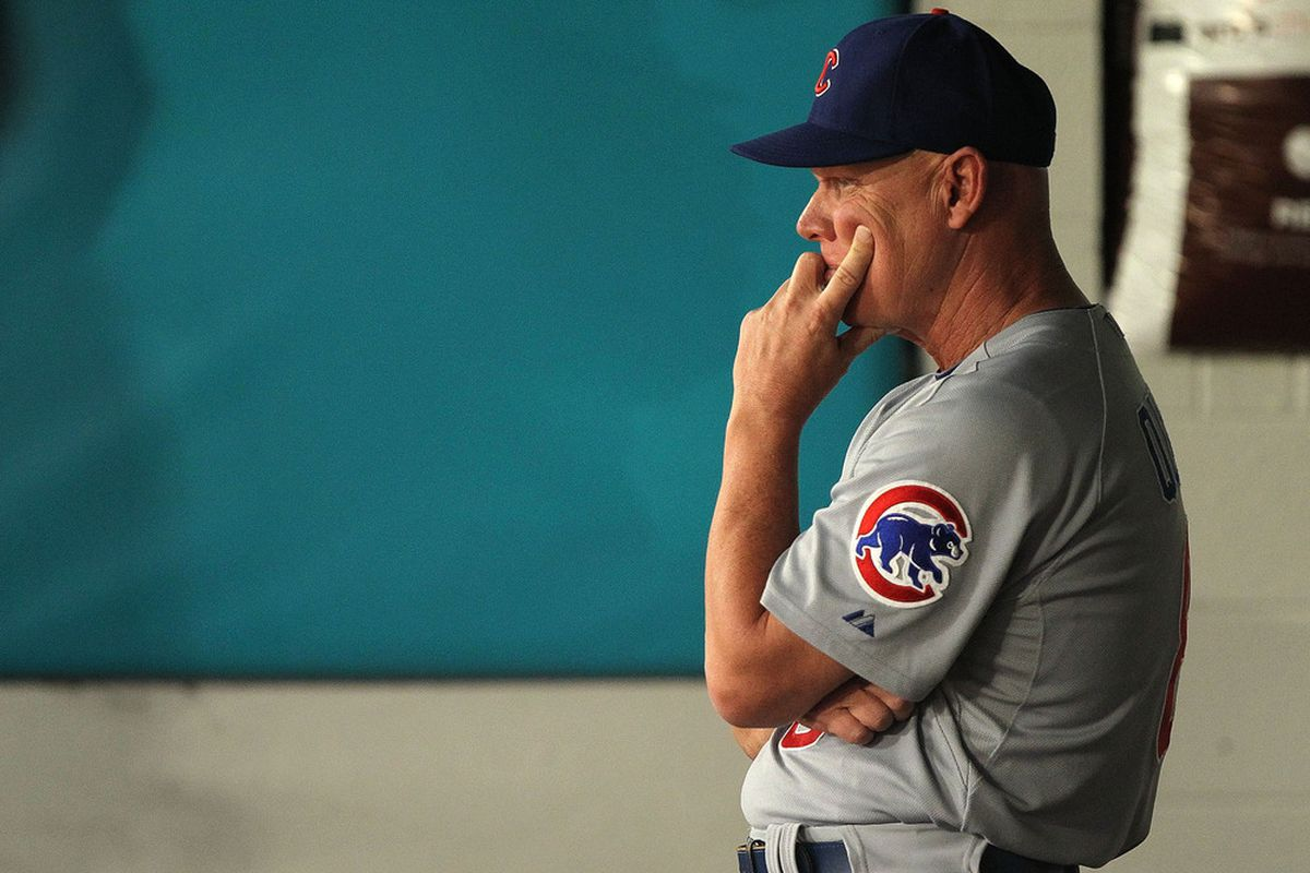 Chicago Cubs manager Mike Quade looks on during a game against  the Florida Marlins at Sun Life Stadium on May 19, 2011 in Miami Gardens, Florida.  (Photo by Mike Ehrmann/Getty Images)