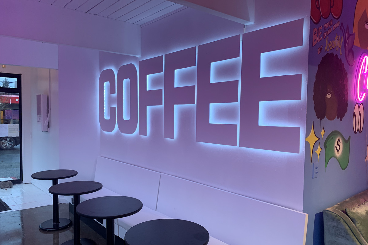 """A giant """"Coffee"""" sign inside West Seattle's Lula."""