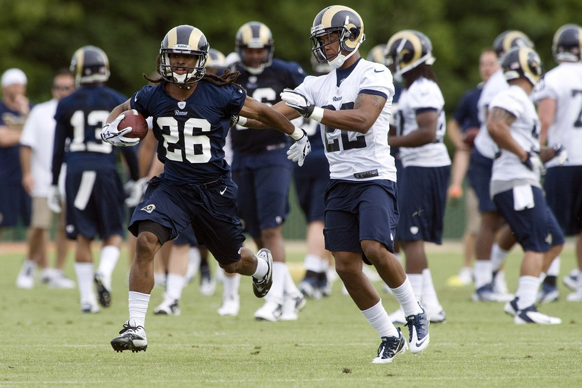 May 11, 2012; St. Louis, MO, USA; St. Louis Rams running back Daryl Richardson (26) runs as cornerback Trumaine Johnson (22) defends during mini camp at ContinuityX Training Center. Mandatory Credit: Jeff Curry-US PRESSWIRE