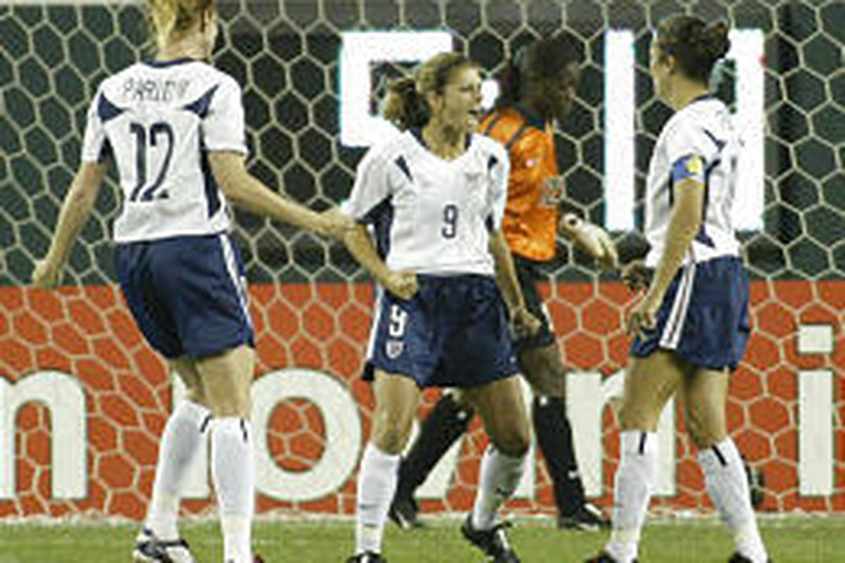 United States' Mia Hamm, center, celebrates her first-half goal as Nigeria's goalie Precious Dede walks behind her in their World Cup game Thursday.