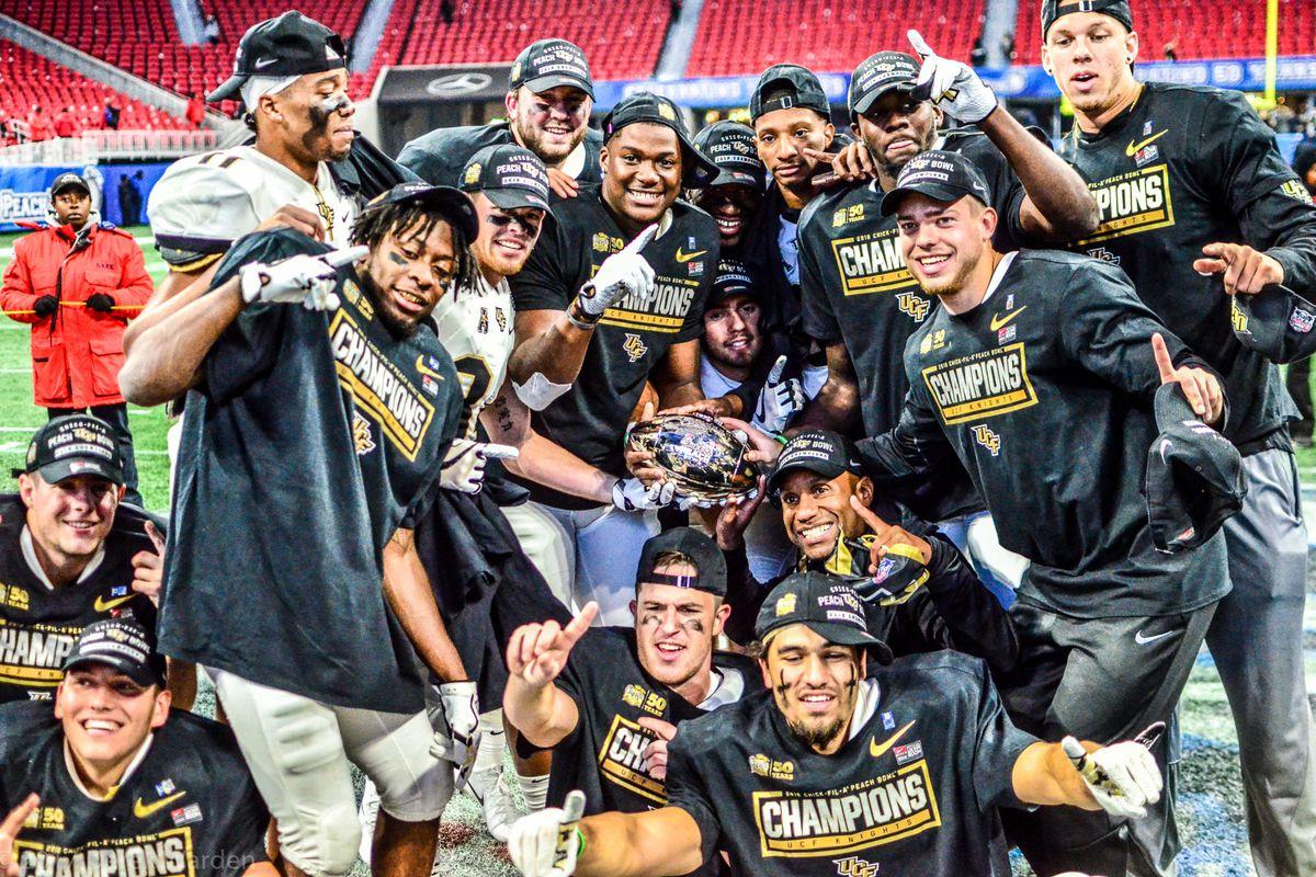 UCF players celebrate their Peach Bowl victory over Auburn (Photo: Derek Warden)