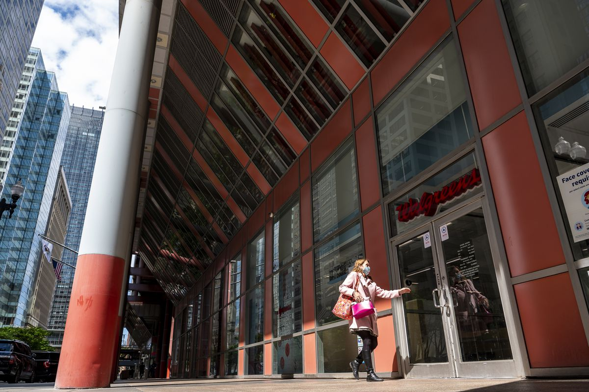 A woman enters a Walgreens located at the James R. Thompson Center, at 100 W. Randolph St. on Monday.