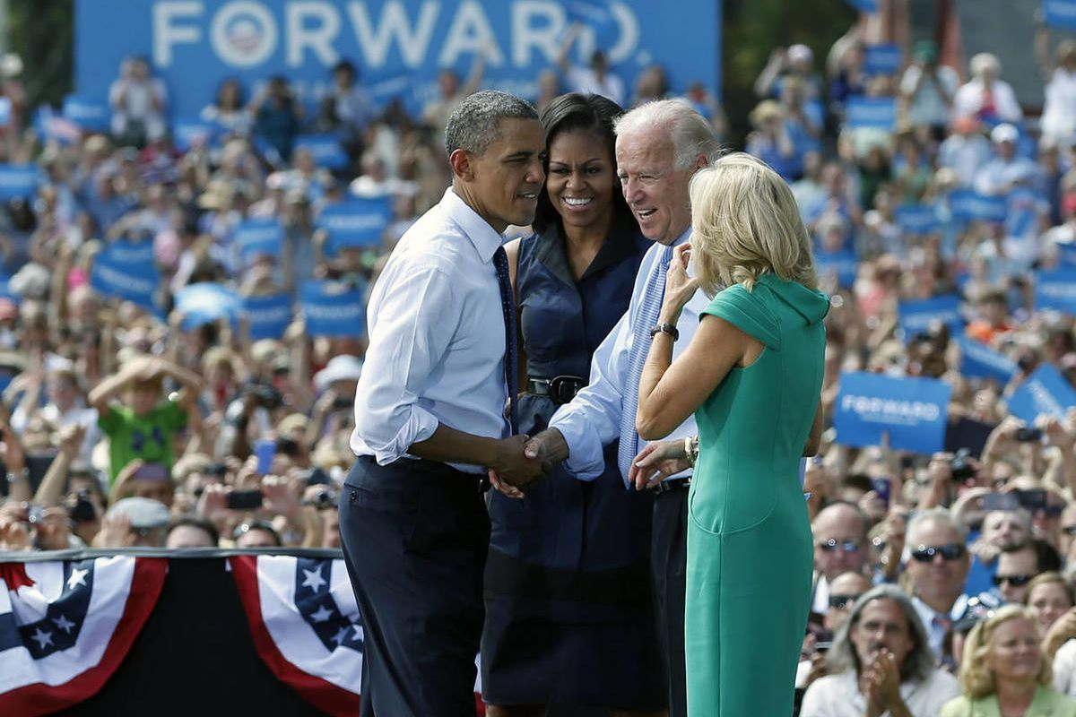 President Barack Obama and Vice President Joe Biden shake hands on stage with first lady Michelle Obama, second from left, and Jill Biden, right, a campaign event at Strawbery Banke Field, Friday, Sept. 7, 2012, in Portsmouth, N.H.
