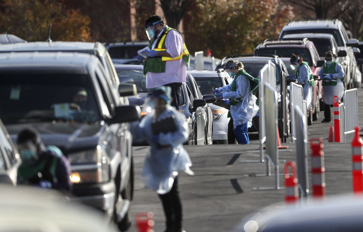 Salt Lake County mobile testers gather information from people as they wait in long lines to get tested for COVID-19 at the county's testing site in the Maverik Center parking lot in West Valley City on Tuesday, Nov. 17, 2020.