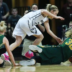 Brigham Young Cougars guard Makenzi Morrison Pulsipher (23) and San Francisco Lady Dons forward Taylor Proctor (32) struggle for the ball during the WCC tournament championship in Las Vegas Tuesday, March 8, 2016. San Francisco won 70-68.
