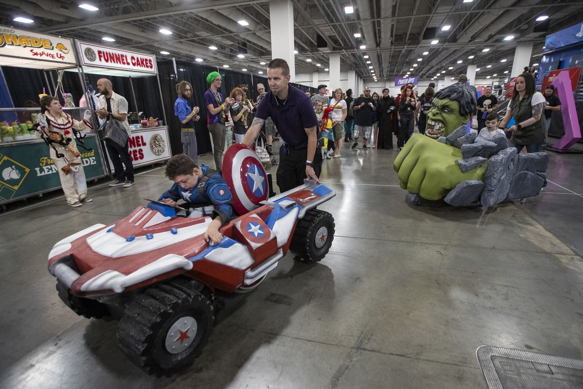 Scott and Crystal Shank push sons Braxden and Jayden in their new, specially built wheelchair costumes during the FanXSalt Lake Comic Convention at the Salt Palace Convention Center in Salt Lake City on Friday, Sept. 7, 2018. Magic Wheelchair, a nonprofit