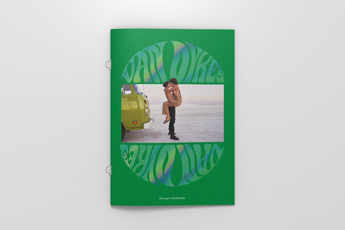 """An image of the Van Dykes Journal cover, which is bright green with bubble typography in an iridescent finish spelling """"Van Dykes"""" and a photograph of a couple kissing in front of a green VW Bus."""