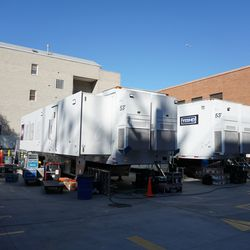 Network broadcast trailers in the media lot on Waveland