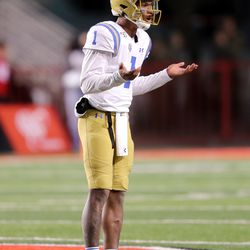 UCLA Bruins quarterback Dorian Thompson-Robinson (1) holds up his hands asking a question to his sideline as Utah and UCLA play a college football game in Salt Lake City at Rice-Eccles Stadium on Saturday, Nov. 16, 2019. Utah won 49-3.