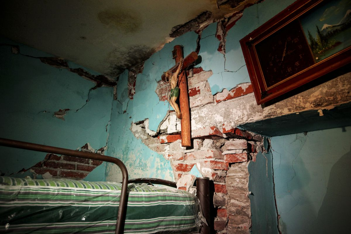 September 21: A cross hangs from a damaged wall in San Gregorio Atlapulco, a neighborhood located in the borough of Xochimilco in Mexico City, two days after a strong quake hit central Mexico. Read More. (Diana Ulloa/AFP/Getty Images)