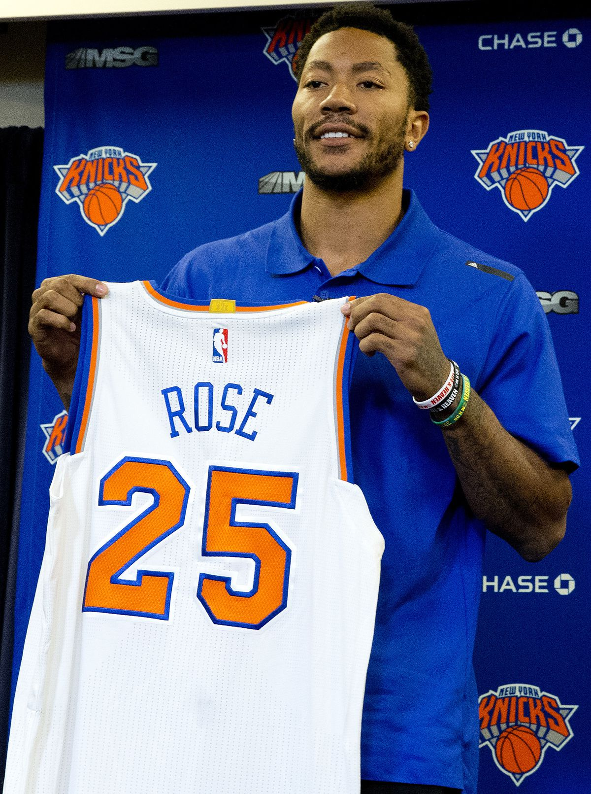 Derrick Rose poses for photographers with his New York Knicks jersey during a news conference on June 24, 2016 in New York. The Knicks introduced Rose, the former NBA basketball MVP they acquired from the Chicago Bulls. | Mary Altaffer/Associated Press