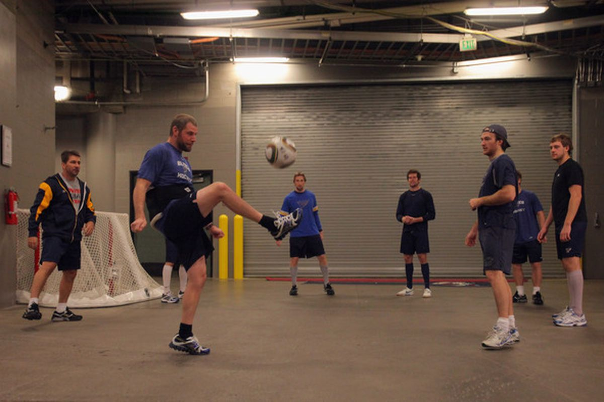 DENVER - NOVEMBER 15:  Members of the St. Louis Blues warm up by playing soccer prior to facing the Colorado Avalanche at the Pepsi Center on November 15 2010 in Denver Colorado.  (Photo by Doug Pensinger/Getty Images)
