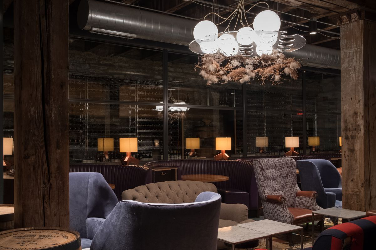 The room at Marvel bar, dark with a mix of contemporary lounge furniture