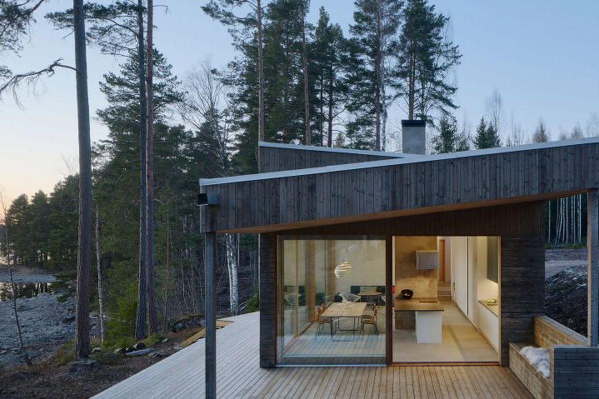 Timber cabin with large wooden deck.