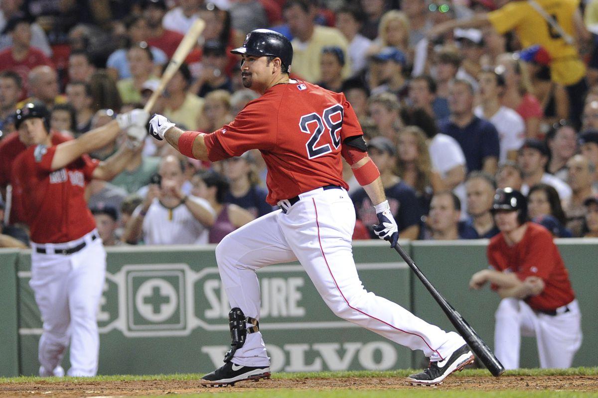 August 3, 2012; Boston, MA, USA; Boston Red Sox first baseman Adrian Gonzalez (28) hits an RBI single during the third inning against the Minnesota Twins at Fenway Park. Mandatory Credit: Bob DeChiara-US PRESSWIRE