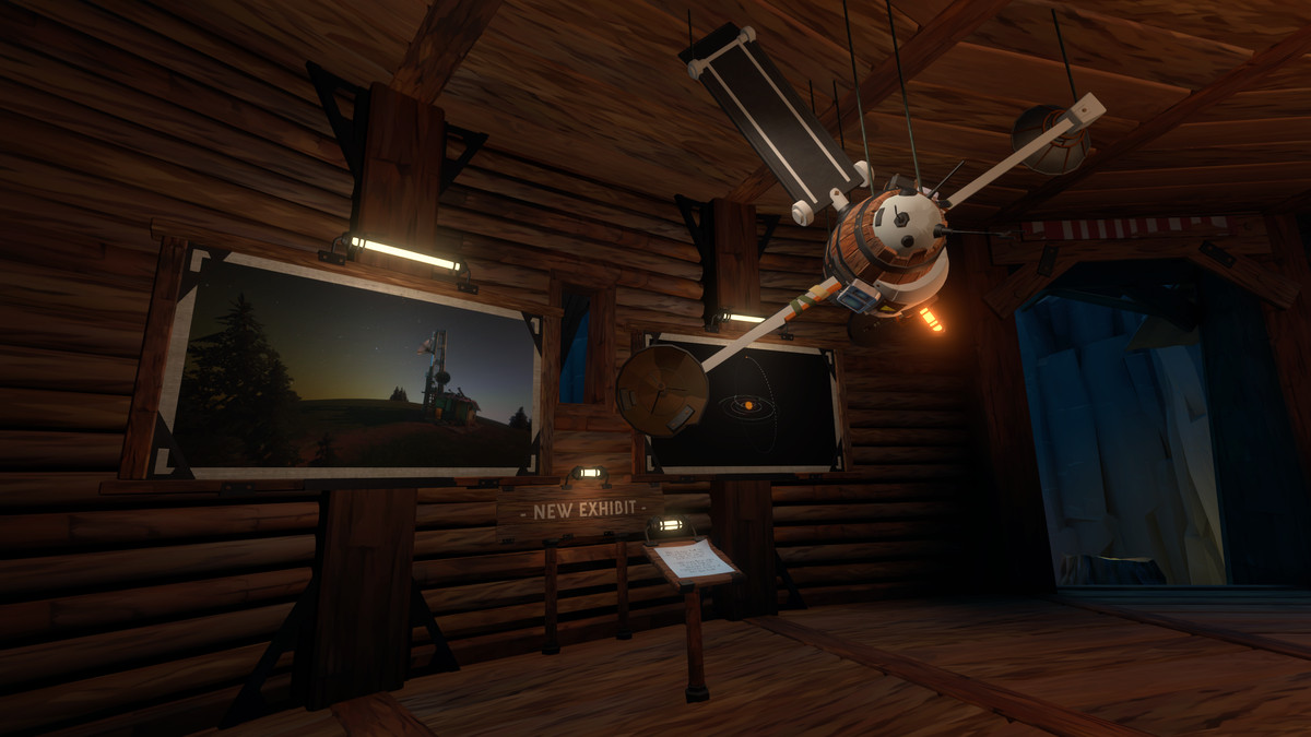 Screenshot from Outer Wilds: Echoes of the Eye depicting a new exhibit in the Observatory. The exhibit contains two images, one is a radio tower on the planet Timber Hearth and the other is a map of the solar system with a satellite orbiting the z axis.