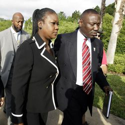 Tracy Martin, back left, Sybrina Fulton, center, parents of Trayvon Martin, and attorney Benjamin Crump, arrive at the Seminole County Criminal Justice Center for a bond hearing for George Zimmerman,  the neighborhood watch volunteer charged with murdering Trayvon Martin, Friday, April 20, 2012, in Sanford, Fla.  Attorney for Zimmerman, Mark O'Mara is asking the Seminole County judge to let Zimmerman post bail at the hearing Friday.