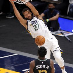Utah Jazz center Rudy Gobert (27) dunks over Memphis Grizzlies forward Jaren Jackson Jr. (13) as the Utah Jazz and the Memphis Grizzlies play in game one of their NBA playoff series at Vivint Arena in Salt Lake City on Sunday, May 23, 2021. Memphis won 112-109.