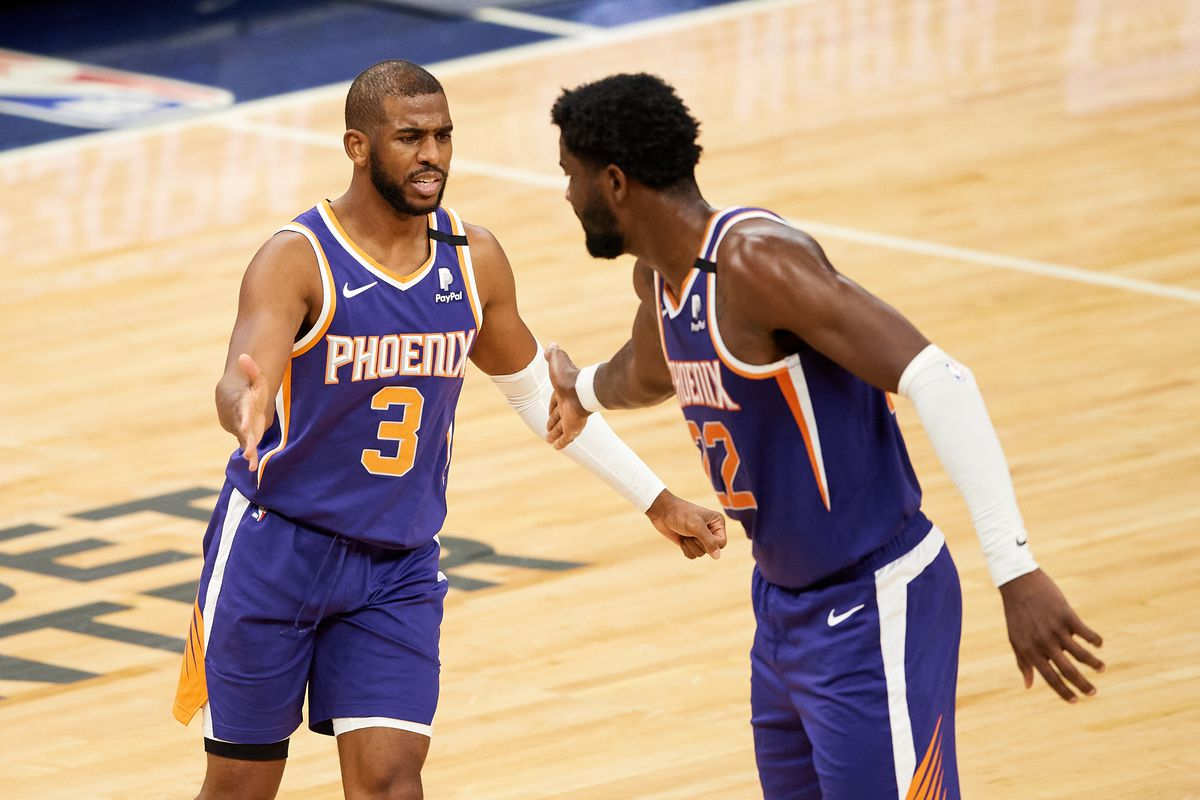 Chris Paul and Deandre Ayton of the Phoenix Suns celebrate a foul by the Minnesota Timberwolves during the fourth quarter of the game at Target Center on February 28, 2021 in Minneapolis, Minnesota. The Suns defeated the Timberwolves 118-99.