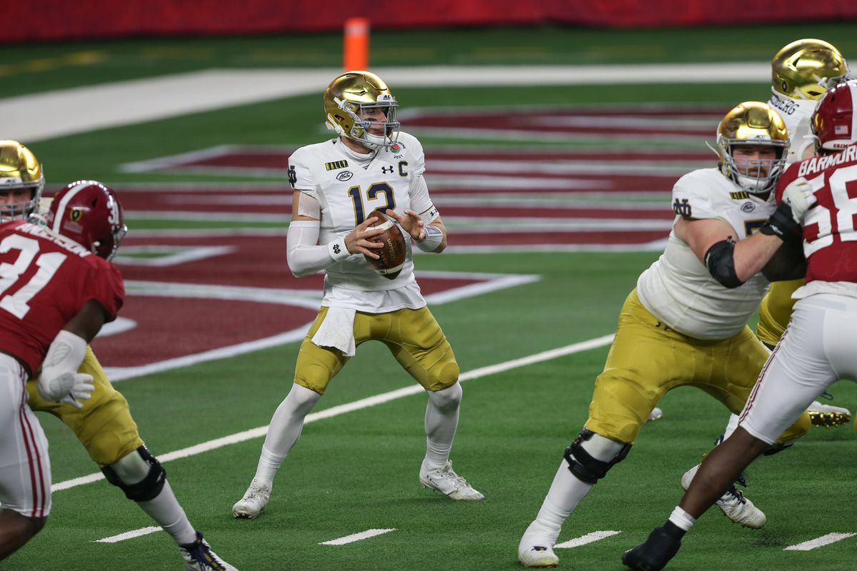 Notre Dame Fighting Irish quarterback Ian Book (12) passes during the College Football Playoff Semifinal Rose Bowl Game between Notre Dame and Alabama on January 1, 2021 at AT&T Stadium in Arlington, TX.