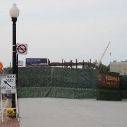5:00 p.m. The new structure in the triangle lot is visible from under the main marquee -