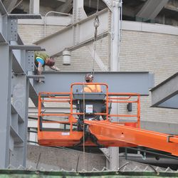 Same girder as in previous photo being attached in right-center field -