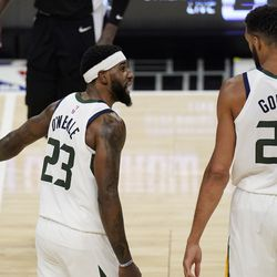 Utah Jazz forward Royce O'Neale, left, exchanges words with center Rudy Gobert during the second half of Game 3 of a second-round NBA basketball playoff series against the Los Angeles Clippers Saturday, June 12, 2021, in Los Angeles.