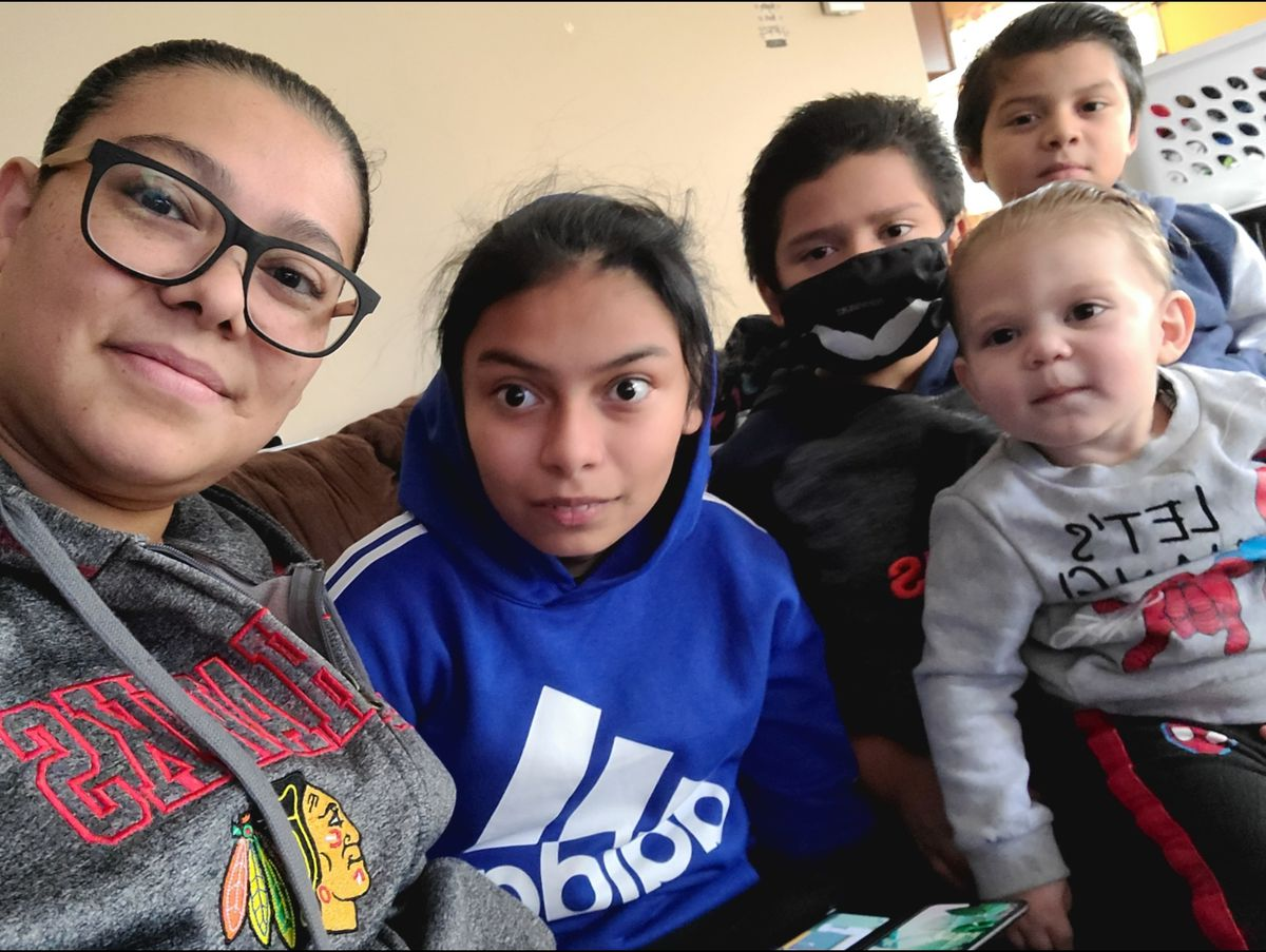 Lesby Ortega is pictured with her four children.