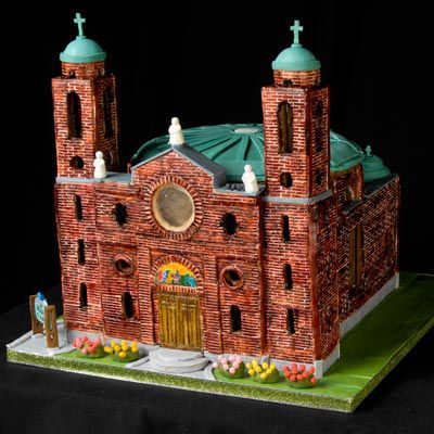 Detailed gingerbread church with brick pattern.