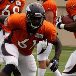 Broncos rookie DE Lanston Tanyi moves to make a hit on the ball carrier in drills