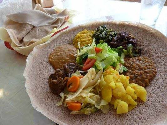 A view of colorful vegetables on top of injera bread at Enat Ethiopian Restaurant.