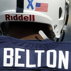 Penn State NCAA college football player Bill Belton warms up before an NCAA college football game against Ohio at Beaver Stadium in State College, Pa., Saturday, Sept. 1, 2012. The blue ribbon on the back of helmets is to show support for child abuse victims.