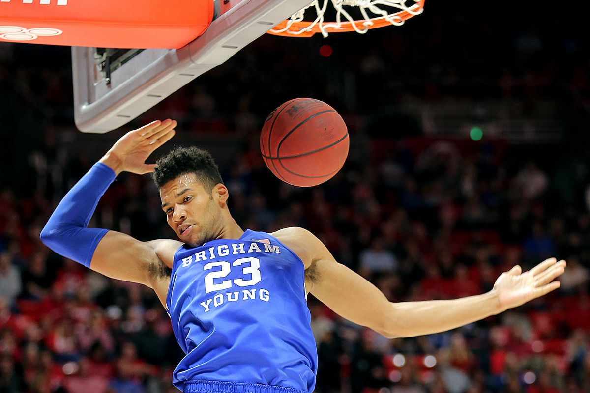 Brigham Young Cougars forward Yoeli Childs (23) dunks the ball as Utah and BYU play an NCAA basketball game at the Huntsman Center in Salt Lake City on Wednesday, Dec. 4, 2019. Utah won 102-95 in overtime.