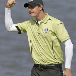 Europe's Nicolas Colsaerts reacts after making a birdie putt on the second hole during a four-ball match at the Ryder Cup PGA golf tournament Friday, Sept. 28, 2012, at the Medinah Country Club in Medinah, Ill.