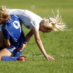 Bingham's Randy Sorenson and Pleasant Grove's Cassidy Lucas get tangled up going for the ball during the Miners' win.