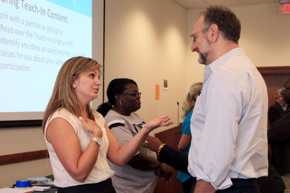 Teachers from schools in midtown Memphis and Frayser practice Facing History and Ourselves activities during a symposium Tuesday at the University of Memphis.