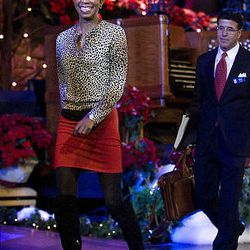 Singer, songwriter and performer Natalie Cole exits the stage after speaking to the media about the annual Christmas Concert at the Conference Center in Salt Lake Friday.
