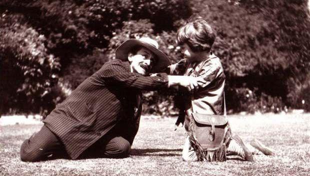 J. M. Barrie(as Hook) and Michael Llewelyn Davies (as Peter Pan)