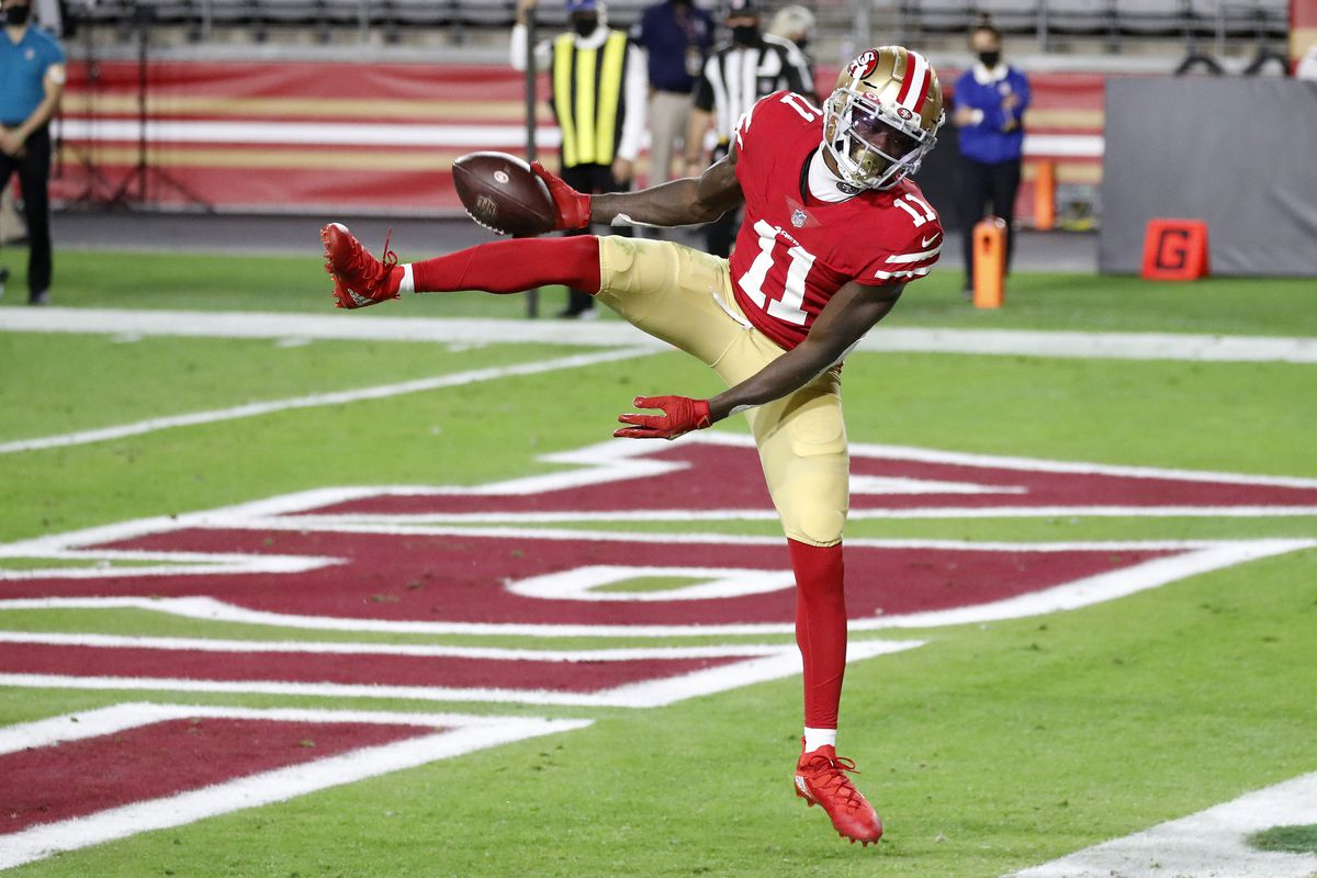 Wide receiver Brandon Aiyuk #11 of the San Francisco 49ers celebrates a two-yard reception for a touchdown during the first quarter of a game against the Buffalo Bills at State Farm Stadium on December 07, 2020 in Glendale, Arizona.