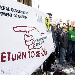 """People protest at a """"Return to Sender"""" event organized by the Healthy Environment Alliance of Utah in Salt Lake City."""