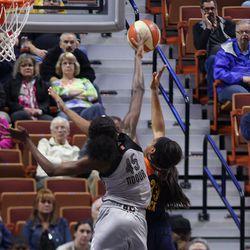 San Antonio Stars' Astou Ndour (45) blocks the layup attempt of Connecticut Sun's Morgan Tuck (33).