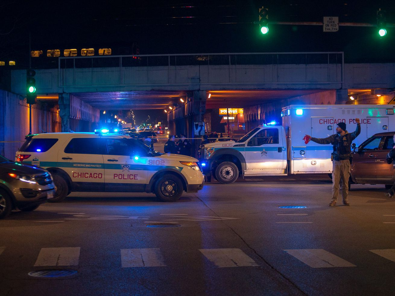 Authorities on the scene where two officers were fatally struck by a commuter train.