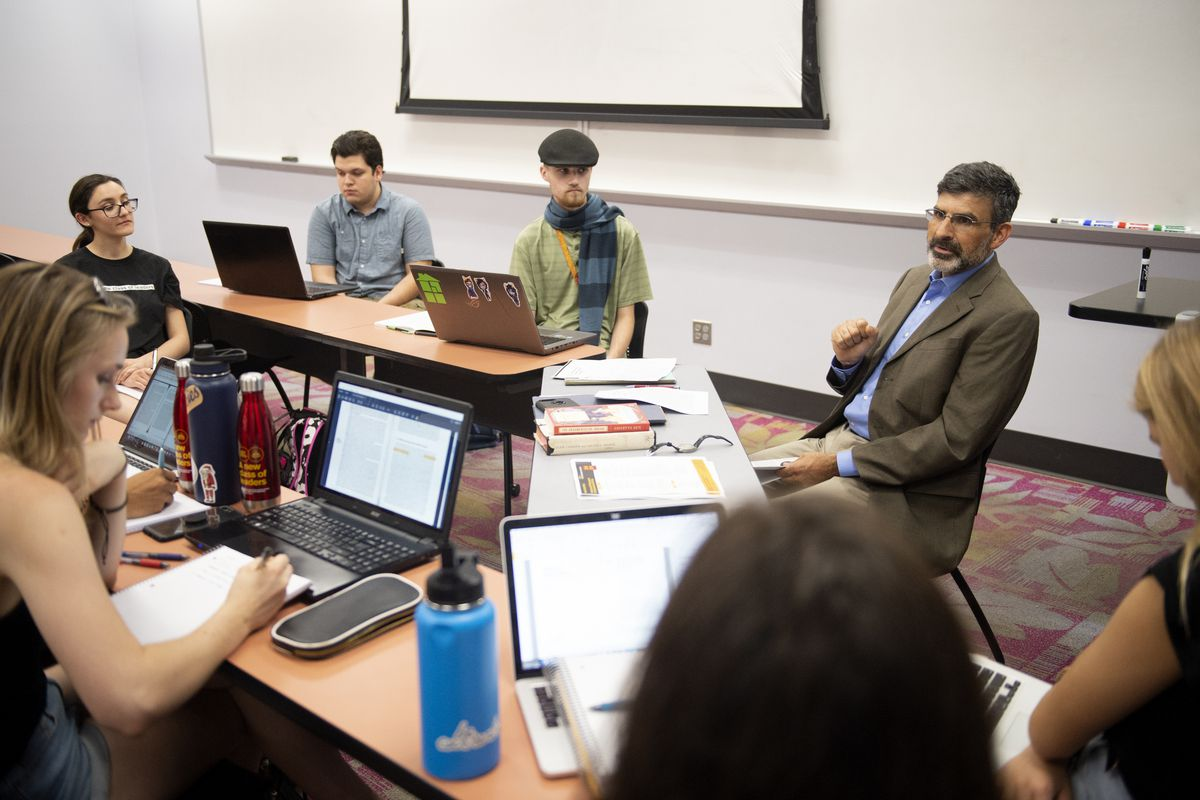Professor Paul Carrese, right, discusses what the group will talk about in his political thought class on Thursday, Aug. 16, 2018, at Arizona State University in Tempe, Arizona.