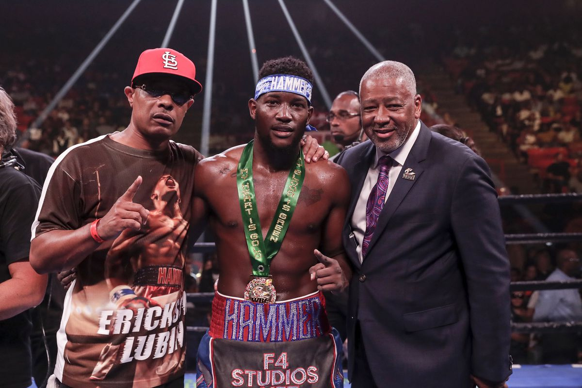 Erickson Lubin celebrates with his trainer after the WBC World Super Welterweight Championship Eliminator against Zakaria Attou at NRG Arena on June 29, 2019 in Houston, Texas.