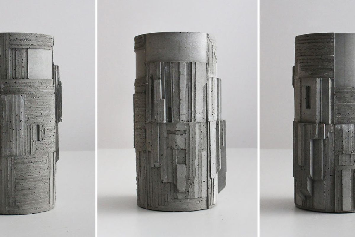 Three cylindrical vases made of concrete with hard lines and patterns that create a 3D effect on the surface.